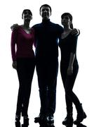Family father mother daughter standing full length looking up  silhouette Stock Photos