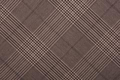 Brown material in geometric patterns, a background or texture - stock photo