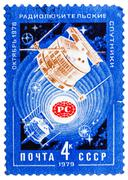 stamp printed by ussr shows satellites radio 1 and radio 2 in space - stock photo
