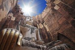 big buddha against sunbeam at wat srichum - stock photo