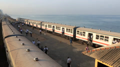 Passenger trains at waterfront station early morning in Colombo Stock Footage