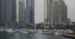 UHD 4K Ship Passing Yachting Club Motor Boat Harbor Pier Dubai Marina Channel Stock Footage