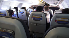Airplane Cabin, Passengers, Seats, Flights - stock footage
