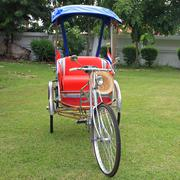traditional thai rickshaw or tricycle - stock photo