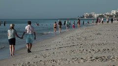 Mature couple and friends on Naples Florida Beach Stock Footage