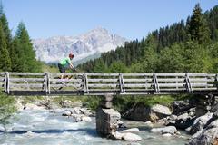 Mountain biker crossing bridge Stock Photos