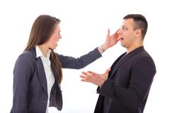 Business woman slapping man's face Stock Photos