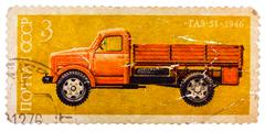 Stamp printed in russia, shows retro truck Stock Photos