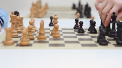 In a chess game on chessboard black queen take white queen Stock Footage