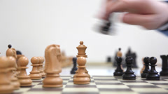 in a chess game on chessboard black queen take white queen - stock footage