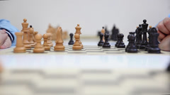 Hands of a two chess players and black queen take white queen Stock Footage