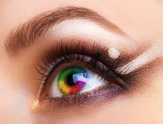 Close up colourful human eye with makeup Stock Photos
