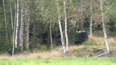 Timber transport will ride through the woods .. - stock footage