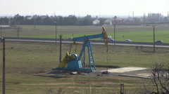 Shut down oil pumpjack, donkey pumper near main road, oil well pump, crude oil Stock Footage