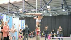 Young teenager with acrobatic program on pylon, Kiev, Ukraine, Stock Footage