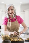 Portrait of Caucasian woman baking cookies Stock Photos