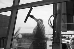 Window washer cleaning window Stock Photos