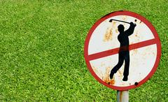 Stock Photo of do not play golf signs with green grass background