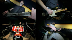 Two Guitarist, drummer and bassist together playing rock n roll Stock Footage