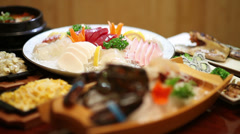Japanese sashimi table focus follow Stock Footage