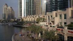 Sun Flares Glass Window Buildings Facade Dubai Marina Waterfront Promenade UAE Stock Footage