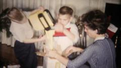 68 - children open gifts on Christmas morning - vintage film home movie Stock Footage