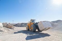 60-ton front end loader in marble quarry Stock Photos