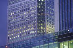High rise office building illuminated at dusk Stock Photos
