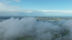 Auckland city skyline and harbour with cloud reveal Stock Footage