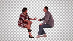 Male & female sit facing each other on alpha matte - stock footage