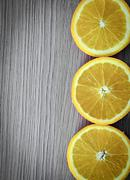 Oranges over Old Woody Background - stock photo