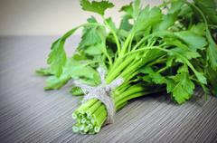Fresh Green Parsley over Woody Old Background - stock photo