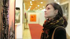 Looking at paintings galleries - stock footage