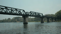 The Famous Bridge Over The River Kwai in Kanchabanuri, Thailand Stock Footage