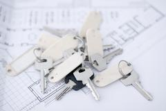 A bundle of keys lying on an architect's plan Stock Photos