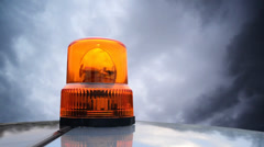 911 Flashing beacon. Orange flashing and rotating light. Stock Footage