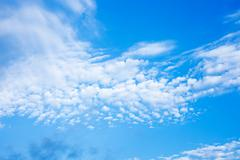 blue sky with fleecy clouds background - stock photo