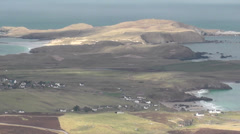 Elevated view of Faraid Head and village of Durness Scotland Stock Footage