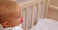 Stock Video Footage of Cute baby girl standing up in her cot