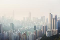 Air pollution hangs over the Happy Valley district of Hong Kong Island Stock Photos