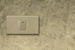 light switch on wall - stock photo