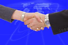 handshake between business people with global network planet map behind - stock illustration