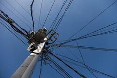 messy electric post wires - stock photo