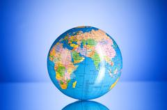 Globalisation concept - globe against gradient colorful backgrou Stock Photos