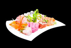 mixed sashimi in white plate isolated on black background,with clipping path - stock photo