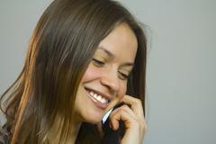 woman talking over mobile phone holding one hand - stock photo