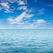 blue clear sea with waves and sky - stock photo