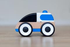 simple wood and plastic toy police car - stock photo