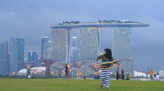 Time Lapse Asia Singapore Skyline over Financial district n Sands hotel Sky Park Stock Footage