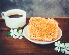 Black coffee and rice puffed on wood background Stock Photos